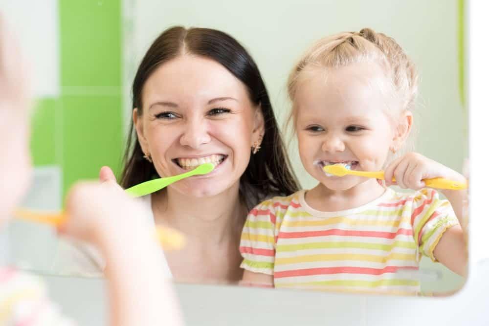 child to brush their teeth